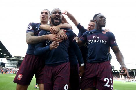 Arsenal players celebrate Alexandre Lacazette's second goal.