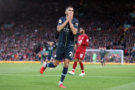 Mahrez reacts to his missed penalty late on.