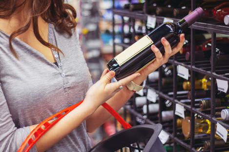 File photo of a woman holding a bottle of wine