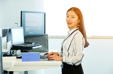 Workers who stand as well as sit 'perform better and are happier'