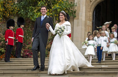 Princess Eugenie married a wine merchant in a windy Windsor Castle ceremony today