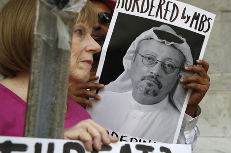 A protester holds a sign of missing journalist Jamal Khashoggi outside the Saudi Arabian embassy in Washington, D.C.