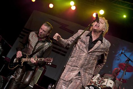 Garry Roberts on stage alongside Bob Geldof in Birmingham in 2013.