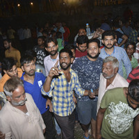 At least 50 dead after train strikes crowd in India