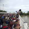 Tense standoff as migrants on way to US met with wall of police at Mexican border