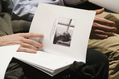 Mourners hold programs with the image of Matthew Shepard.