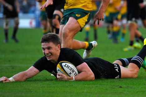 Beauden Barrett scores New Zealand's third try in Yokohama.