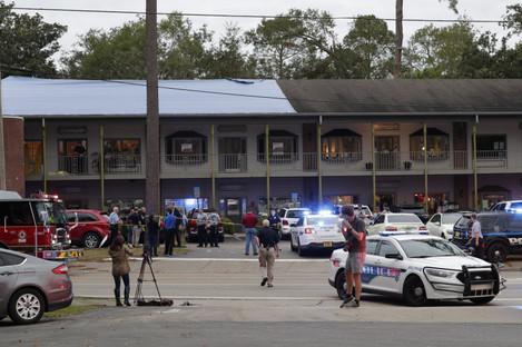 Police investigators work the scene of the shooting