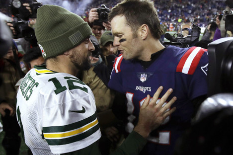 Green Bay Packers quarterback Aaron Rodgers, left, and New England Patriots QB Tom Brady speak at midfield.