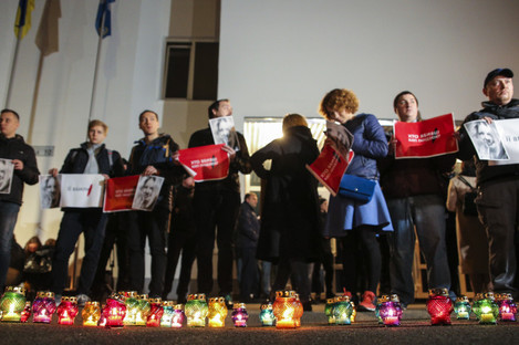 Hundreds of people turned out for a vigil at Kiev's Internal Ministry.