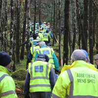 Men's Sheds volunteers descend on Killarney National Park to fight invading rhododendrons