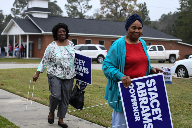 Supporters of Georgia gubernatorial candidate Stacey Abrams pictured yesterday. Abrams, who could became the US's first African American woman governor, is in a close tie with opponent Brian Kemp in one of the most-watched midterm races.