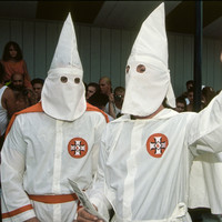Men arrested over photos of group in KKK hoods and costumes in Co Down