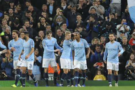 Manchester City players celebrate after scoring in the Champions League during the week.