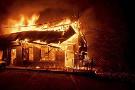 Fire tears through Paradise, California on Thursday.