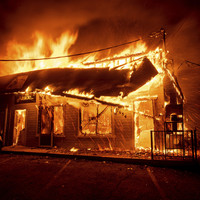 Fast-moving wildfires kill at least five people and force 157,000 to evacuate their homes in US