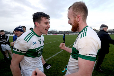 Portlaoise's David Seale and Ciaran McEvoy celebrate at full-time.