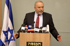 Why did Israel's Defence Minister resign over a ceasefire with Palestinian militants?
