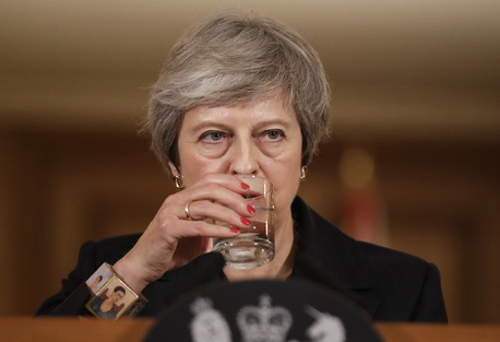 Prime Minister Theresa May takes a sip of water as she holds a press conference at 10 Downing Street