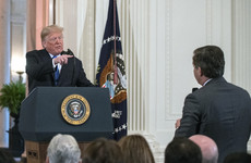 Judge delays ruling over revoked White House credential for CNN reporter