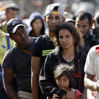 Over 1,500 caravan migrants arrive at US border after over a month on the road