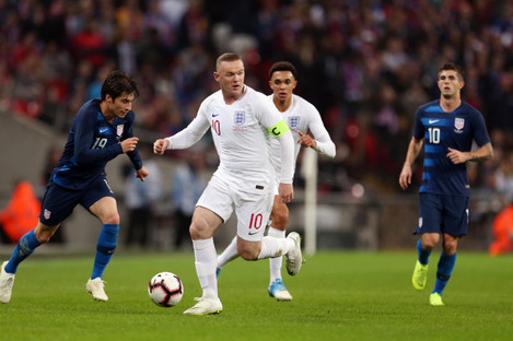 Rooney in action at Wembley for the final time.