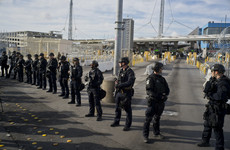 Tensions rise at US-Mexico border as migrants protest amid army show of force