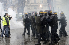Paris police use tear gas and water cannon on anti-Macron tax protesters