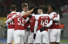 Arsenal progress as group winners after three first-half goals in cold Kiev