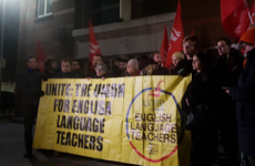 Supporters of English language teachers protest at school after sudden closure
