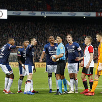 Feyenoord fans throw extra ball onto the pitch just as PSV were about to score
