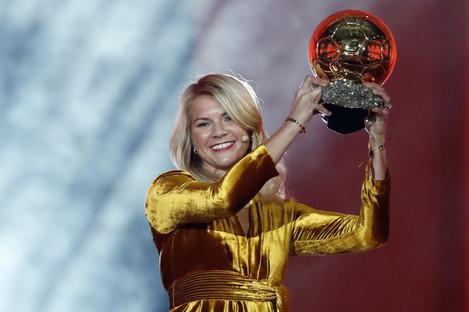 Ada Hegerberg celebrates with the Women's Ballon d'Or award.