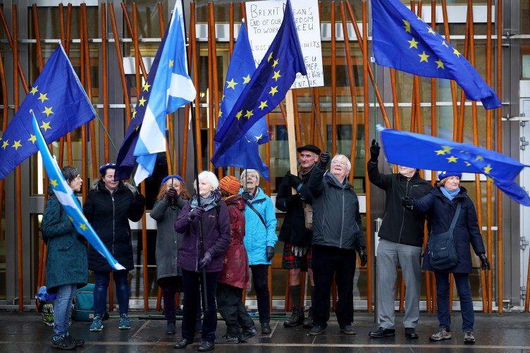 Pro-European protestors outside the Scottish Parliament, Edinburgh, as a vote is held against Theresa May's proposed Brexit deal.