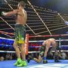 Three-weight world champion Lomachenko unifies lightweight belts with explosive finish