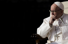 Pope Francis removes two scandal-hit cardinals from his inner circle