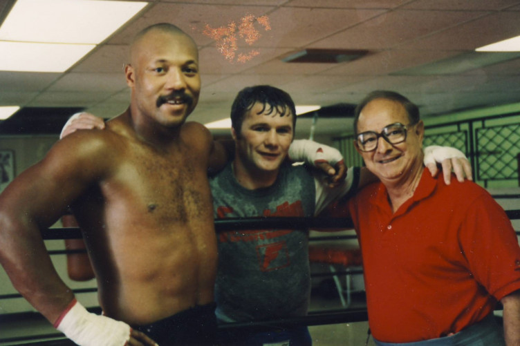 Mannion, centre, pictured with legendary trainer Angelo Dundee (right) and then-World Heavyweight champion Pinklon Thomas.