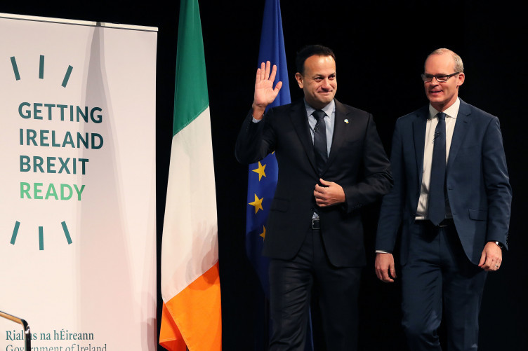 Varadkar and Coveney arrive at an event to brief businesses on Brexit plans.