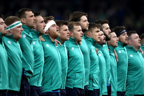 Ireland's rugby team lines up for the national anthem in