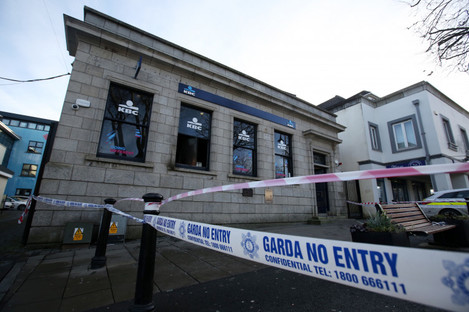 Windows at the Swords branch of the bank were smashed yesterday morning and a fire was set inside.