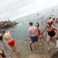Photos: Festive swimmers brave the Forty Foot for annual Christmas dive