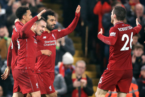 Liverpool players celebrate after a goal against Newcastle on St Stephen's Day.