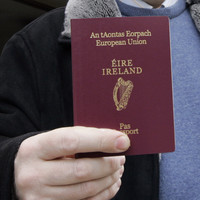 Tánaiste says TDs using their offices for passport deliveries is 'unhelpful'