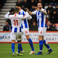 Burnley through thanks to Woods' 90th-minute penalty, while Brighton overcome Bournemouth