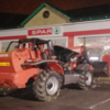 Thieves attempt to steal ATM, then set digger on fire