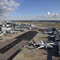Flights resume at Heathrow Airport after suspected drone sighting.