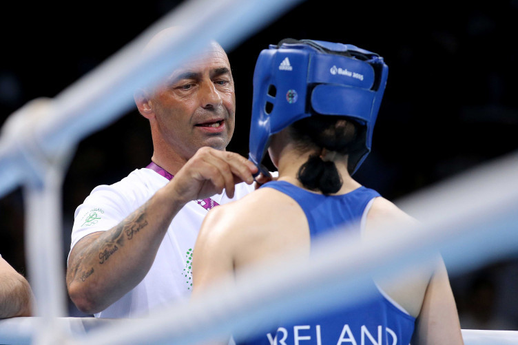 Pete Taylor removes Katie Taylor's headguard after a fight at the 2015 European Games.