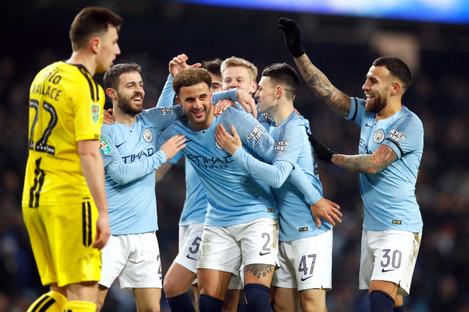 Man City players celebrate.