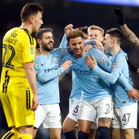 Man City put 9 past Burton Albion to keep quadruple dream alive