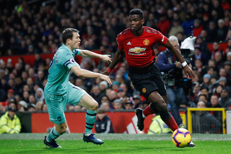 Paul Pogba skips away from a tackle during Manchester United's Premier League tie at home to Arsenal.