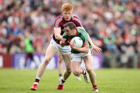 Mayo's Keith Higgins under pressure from Peter Cooke of Galway during last year's Connacht championship.